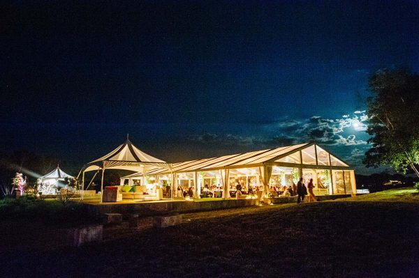 House Island wedding tent and lighting at night
