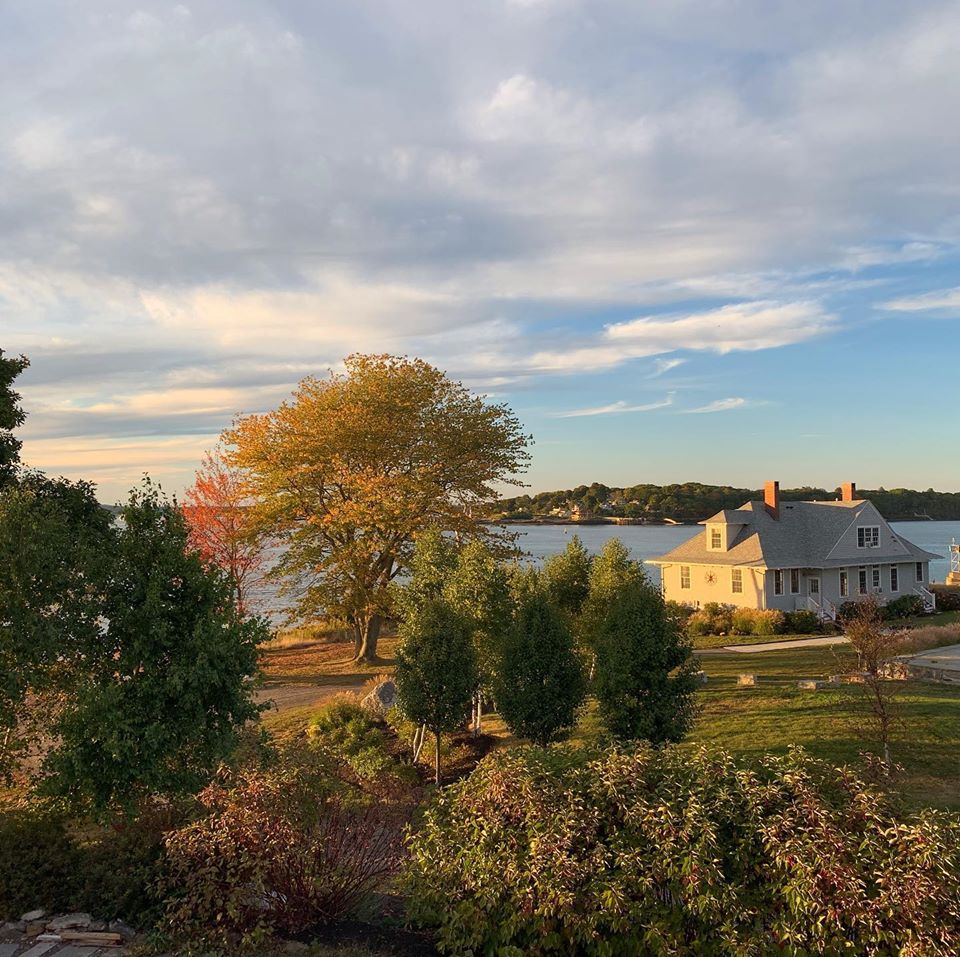 A golden sunset illuminates Cappy's Lodge in a photograph taken from the Solar Barn on House Island, Portland Maine